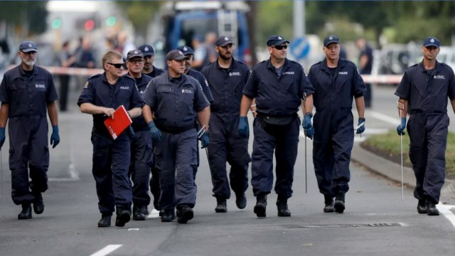 Police officers search the area near the Masjid Al Noor mosque after the terror attack in Christchurch. CREDIT:AP