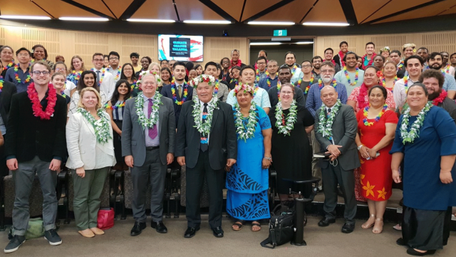 Figure 1 In 2018, Nicole Haley (front row, black dress) hosted the Prime Minister of Tuvalu, Rt Hon Enelse Sosene Sopoaga, and his wife (front row, centre) at an event with Pacific Island students at ANU