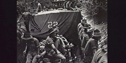Photograph courtesy of the Australian War Memorial (Australian infantry from the 2/9th Battalion move along the Riko River; Balikpapan, August 1945.)