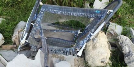 The remains of a baby's cot after bulldozers have been through an urban settlement. Image Siobhan McDonnell