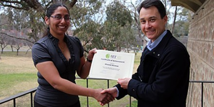Bhavani Kannan receiving her prize for winning the CAP Final of the #3MT competition