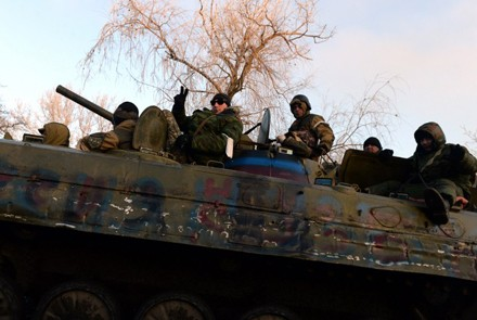 Pro-Russian rebels ride an armoured vehicle in Ukraine. Photo by AFP.