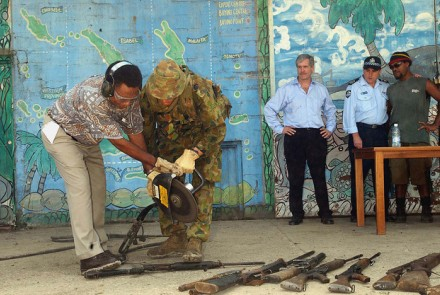 RAMSI soldier destroying weapons. Image from Flickr, courtesy of the Australian Civil-Military Centre.