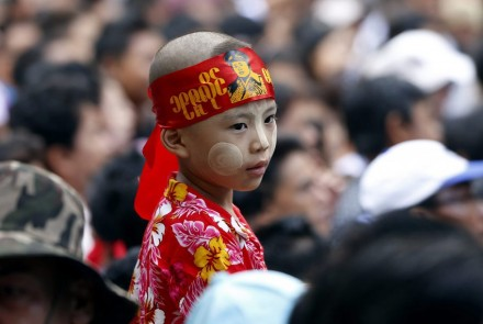 A CHILD WAITS OUTSIDE THE MAUSOLEUM ON MARTYRS' DAY. PHOTO: FINANCIAL TIMES/EPA