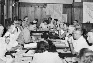 Photograph courtesy of the Australian War Memorial: The Consular Commission meeting with Dutch officials in September 1947. Australian peacekeepers Chesterman and Dyke are at the rear, right. (AWM: P03531.003)