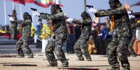 Shan State army commanders take aim during a military parade marking the Shan National Day in February Photo by AFP Images