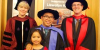 Photo of Professor Charlesworth, Dr Lamcheck and Dr Farrell with daughter Iraya