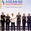 Asean leaders link arms at the opening ceremony of the association's 30th gathering in Manila. Photo: Reuters